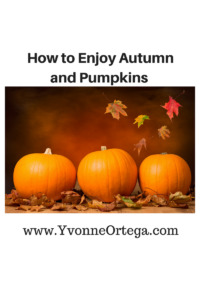 3 pumpkins and autumn leaves